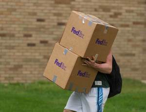 Student carrying boxes.