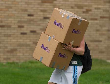Student Carrying Boxes