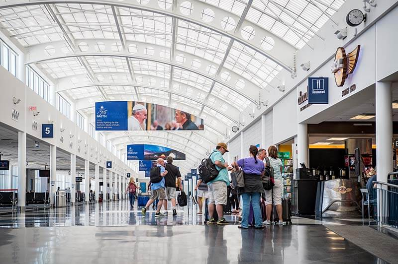 People milling about the South Bend Airport, with Notre Dame banners hanging from the ceiling.
